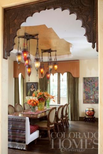 A Vintage Carved Wood Arch Leads To Dining Room Graced With Art And Antiques