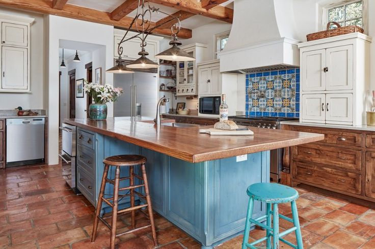mediterranean kitchen design hanging lamps flowers old chairs stove wall cabinets wooden chair
