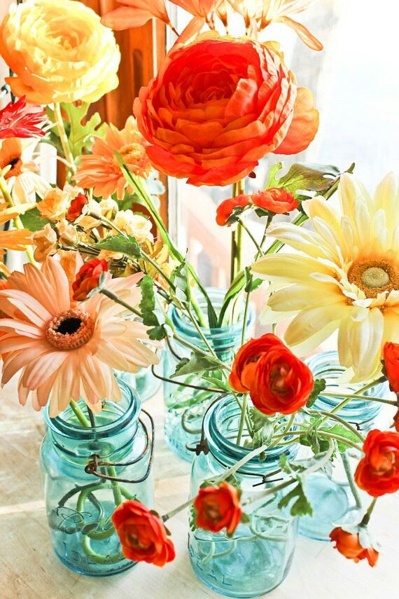 LOVE the teal glass Mason/Ball jars with the bright flowers! Very do-able.