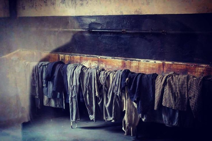 --- Photo by @dyonnezwart --- Auschwitz I. Block 11. Undressing room where men had to take off their clothes before they were shot at the execution yard which was located outside the block.