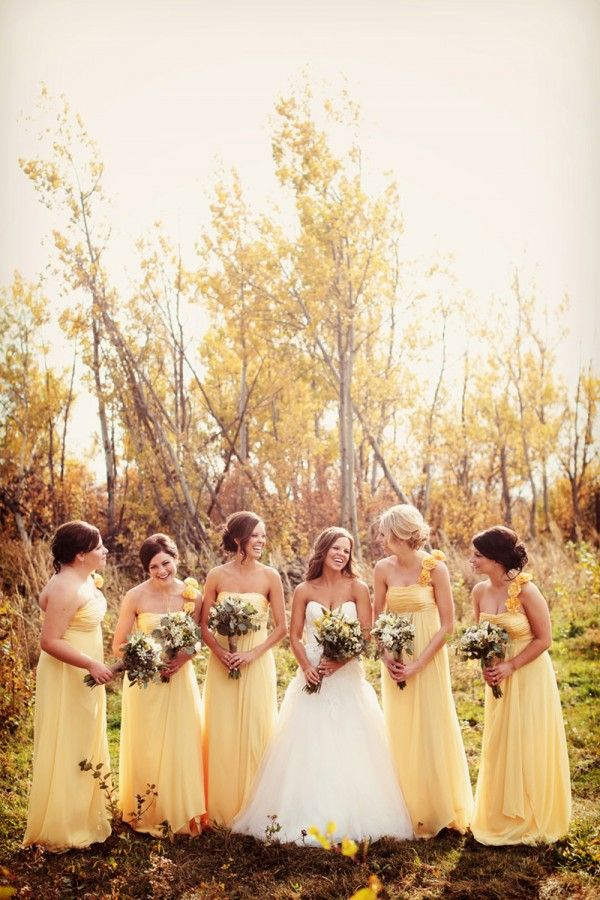 Rustic Country Wedding. The yellow is very pretty & I like how the MOH dress doesn't have the shoulder strap.