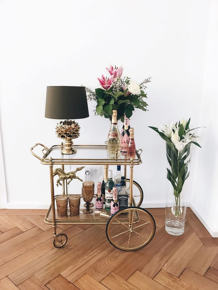 gold / lucite bar cart, vintage - also loving the flowers arranged in a wine glass! #home #decor