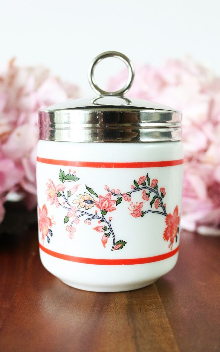 Williams-Sonoma Egg Coddlers -  set of two porcelain egg coddlers made by Williams-Sonoma and discontinued since. The egg coddler was designed to prepare and serve sift boiled eggs. Feminine and cheerful these egg coddlers feature pretty pink cherry blossoms.