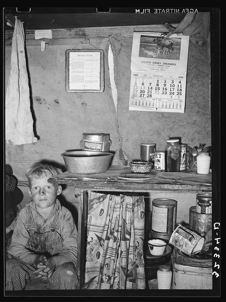 Child of migrant sitting by kitchen cabinet in tent home near Edinburg, Texas. Photo by Lee Russell Feb 1939. Library of Congress Prints & Photographs Division Washington, DC