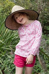 Look out sunshine!  Cabana Pink, great for covering up in the sun and helping to protect precious skin. Cool, comfortable, lightweight cotton girls top sizes 1-12 years. Designed in Australia, soft, high quality fabric made exclusively for Three Sun Possums