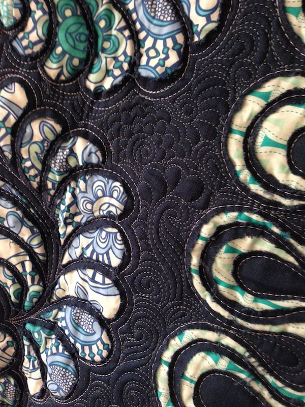 Reverse appliqué quilting with pretty organic shapes