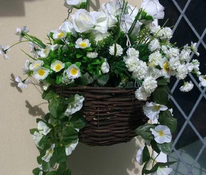 White artificial hanging basket