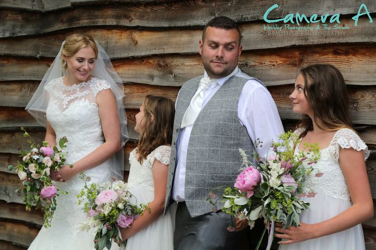 Such a lovely moment caught of a family on the bride and grooms wedding day.