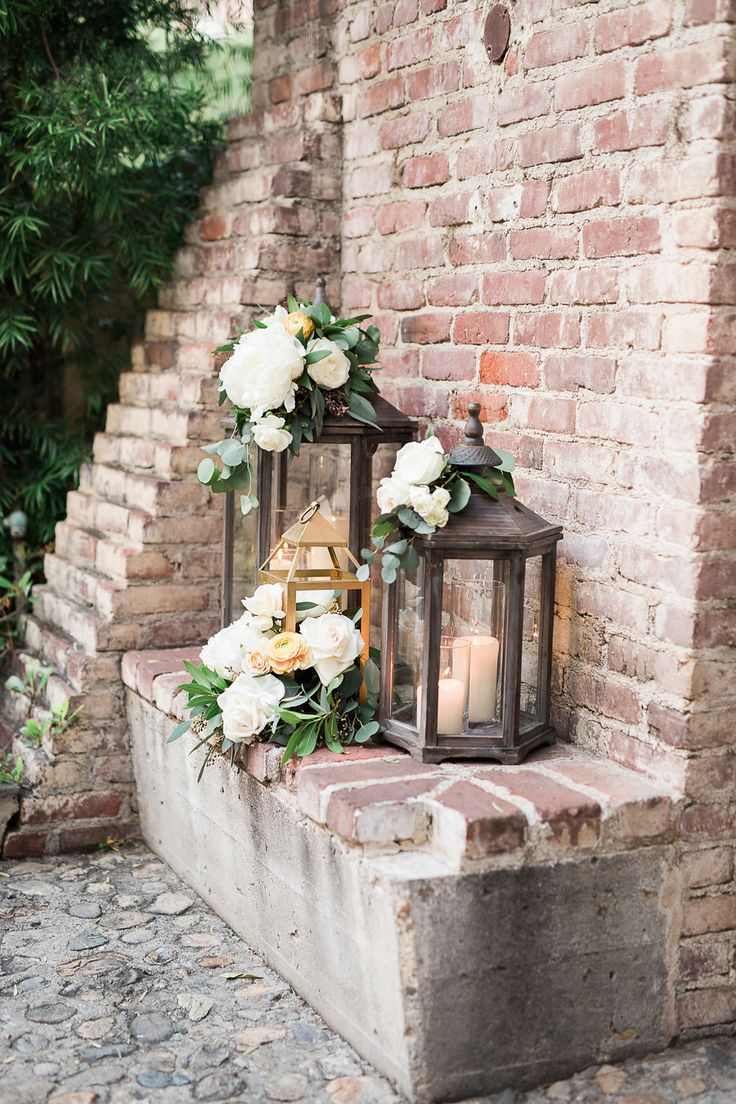 lanterns with candles and flowers wedding decor