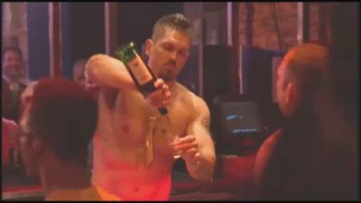 Kev (Steve Howey) works the crowd at his new job as bartender in a gay club, from Season 7 Episode 11 of Shameless (animated gif)