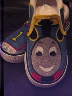 Thomas the Train custom handpainted shoes by ButtercupCustoms, but they are $45.99. Dylan would LOVE these, wonder if there is directions on DIY shoes like this