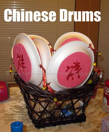 Celebrate Chinese New Year with Paper Plate Drums and free printable Dragon Masks.