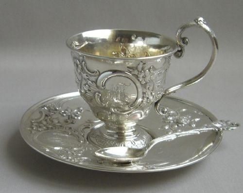 Antique British silver tea cup.