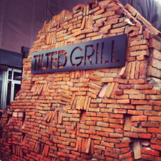 Tilted Grill sign in Calgary. The irregular masonry makes it almost look like a random pile of bricks!