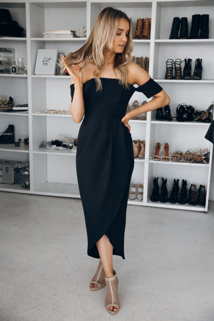 The celebration season has arrived and the Kendra Midi Dress in Black is your must-have little black dress this summer. Off-shoulder styling will keep you cool whilst the front draping brings elegance and class to this dress. fit: standard sizing, fitted body-con style, off shoulder style, medium weight fabric, lined, pleats in front, exposed back zipper colour:   black fabric:   65% polyester, 35% cotton length: approx. 86cm from waistline to longest point of hemline our model is 163cm…