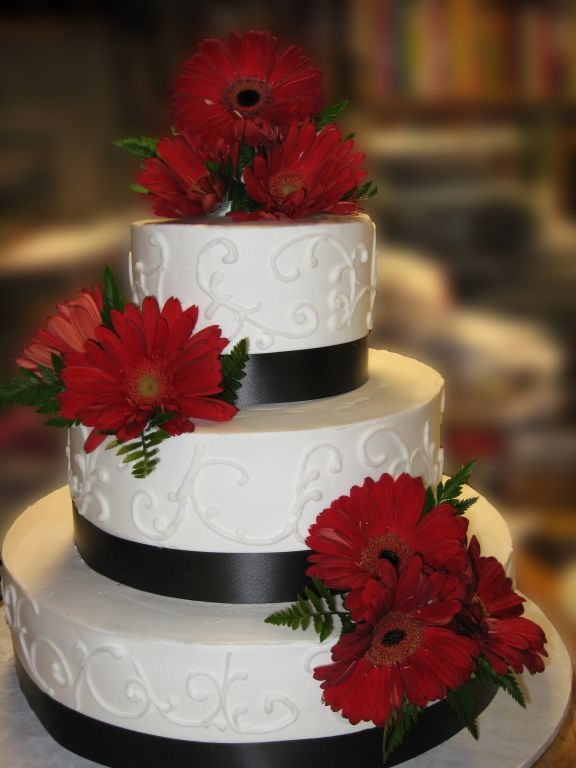 Black, red and white are always classic and never go out of style. Red daisies, black ribbon, wedding cakes, 3 tier cakes, http://tiered-expressions.com