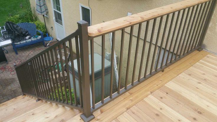 Westbury bronze aluminum railing, with drink rail on top.
