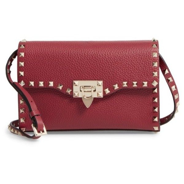 Women's Valentino Medium Rockstud Leather Messenger Bag (£975) ❤ liked on Polyvore featuring bags, messenger bags, rubin, valentino messenger bag, valentino bag, leather messenger bag and spike bag