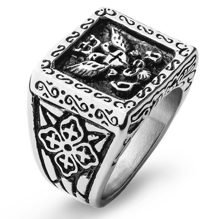 This mens stainless-steel shield ring is both well-crafted and attractive. This ring features a carved religious motif. The intricate carvings boast a modern detail, while the stainless-steel composition will hold up to everyday wear.