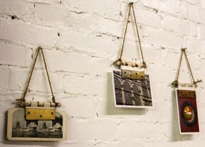 Looking for a new way to display artwork? DIY Network shows you how to upcycle old door hinges into magnetic picture holders.