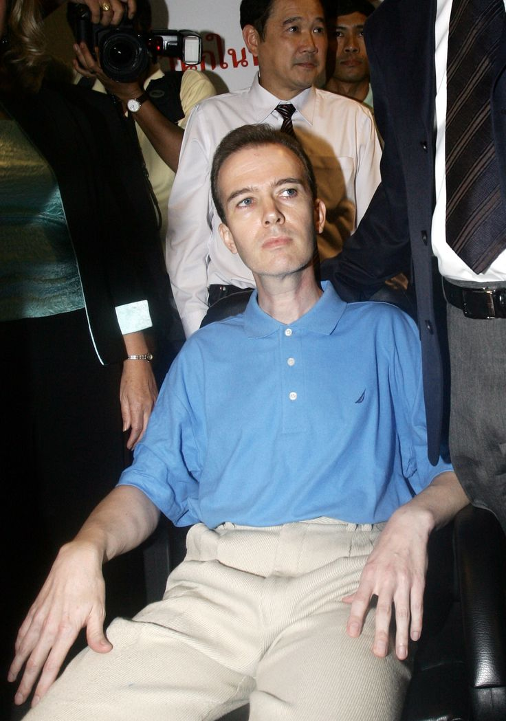American John Mark Karr sits as he is shown at a police news conference at Immigration office in Bangkok, Thailand Thursday, Aug. 17, 2006. Thai police said that Karr, a 41-year-old American schoolteacher, admitted to the killing a decade ago of 6-year-old beauty queen JonBenet Ramsey in the United States _ a sensational crime some feared would never be solved.  Lt. Gen. Suwat Tumrongsiskul, head of Thailand's immigration police, told The Associated Press that John Mark Karr confessed to…