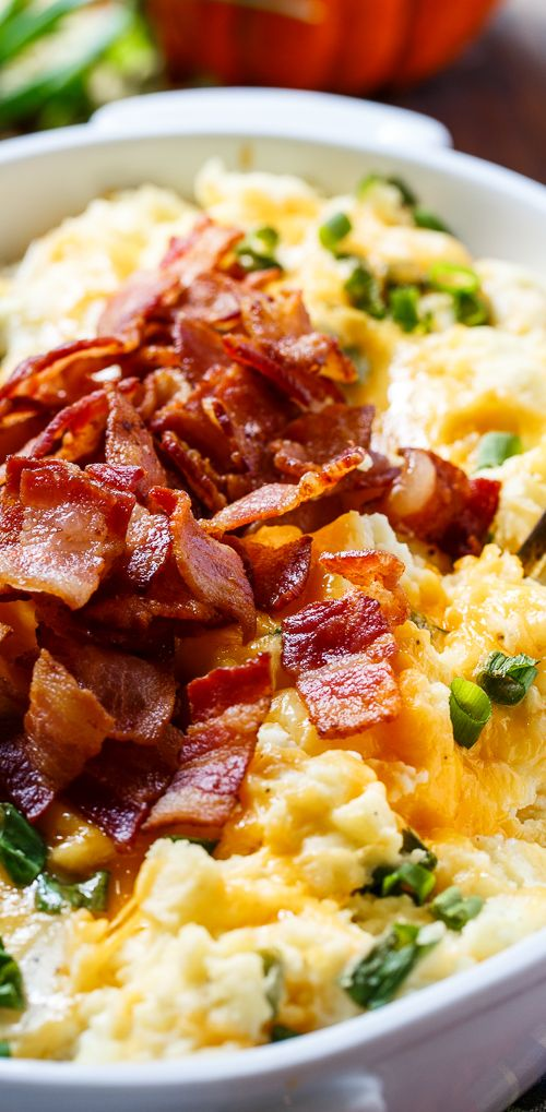 Loaded Mashed Potato Casserole with sour cream, cream cheese, bacon, and cheese.