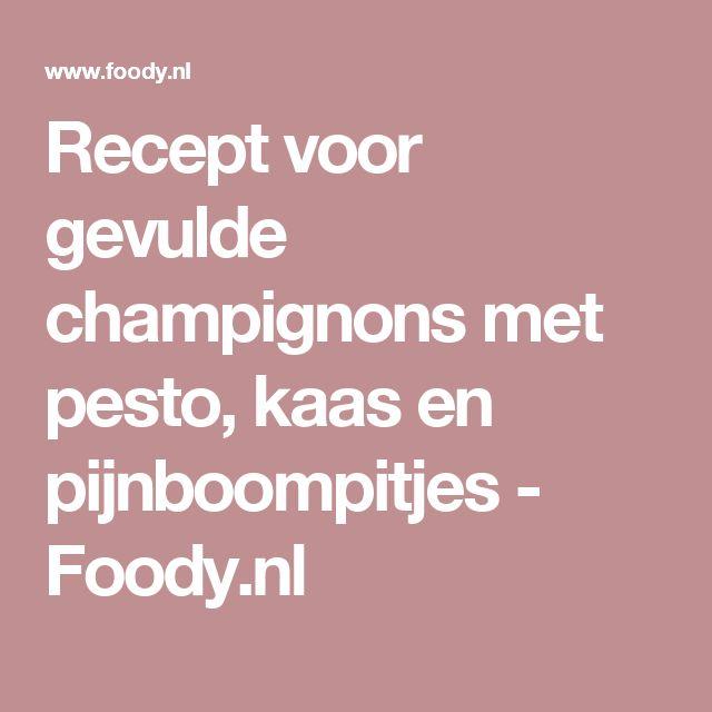 Recept voor gevulde champignons met pesto, kaas en pijnboompitjes - Foody.nl