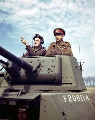 Canadian Lieutenant General Henry Crerar (1888-1965) and Lieutenant Clifford Smith from the Royal Montreal Regiment in the turret of a Daimler armored car.