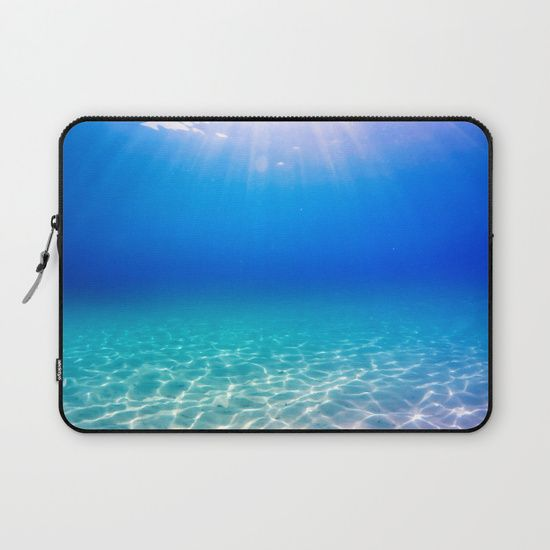 Underwater picture taken in Greece on a beautiful sandbeach with crystal clear water and the sun rays shining through the surface, creating a display of glowing patterns on the bottom. #underwater #water #sea #ocean #beach #summer #travel #adventure #blue #swimming #freediving #diving #laptop #sleeve