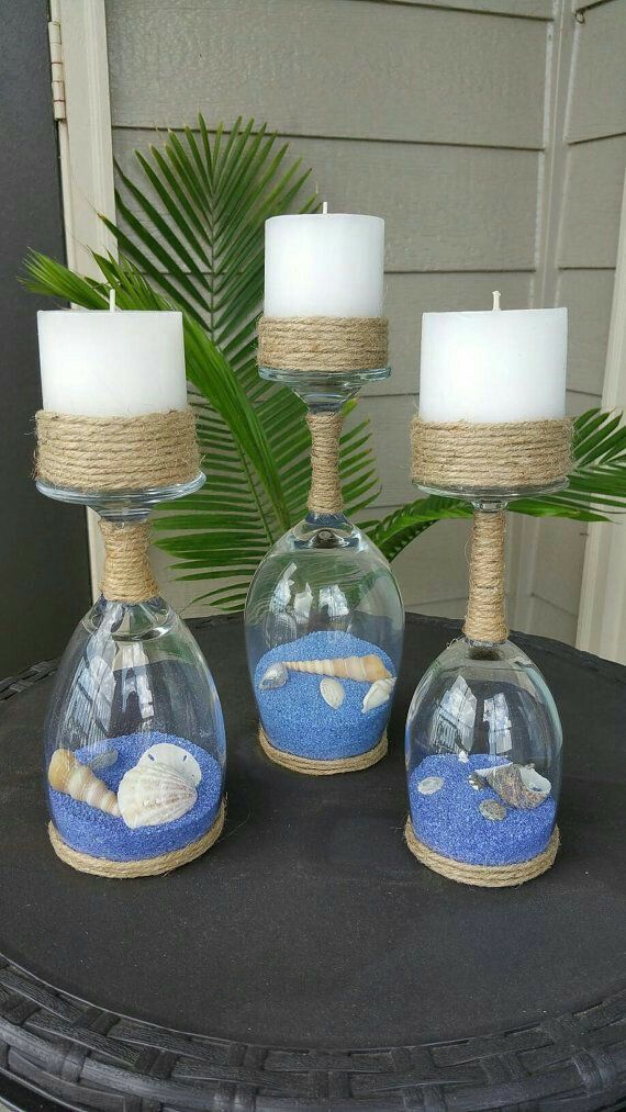 Sand wine glass centerpiece... turquoise sand, surrounded by coral Peruvian lilies