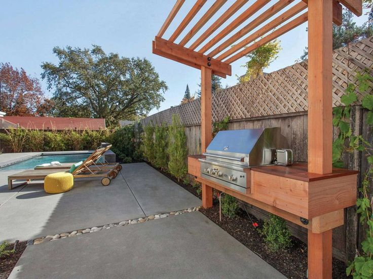 The backyard includes a customized barbecue and trellis. Photo: Open Homes Photography / ONLINE_CHECK