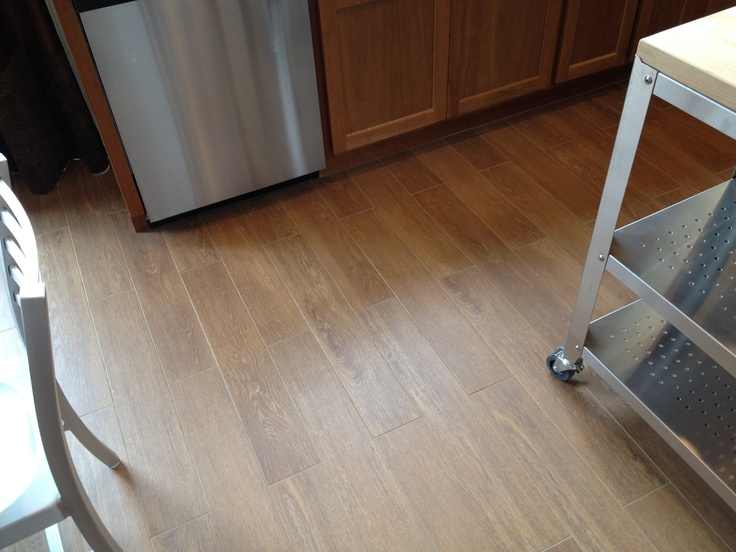 "Ceramic ""wood"" tile.  I read an article that says one of the best floors for the basement is ceramic or porcelain tile.  This might work--the look of wood but the benefits of tile."