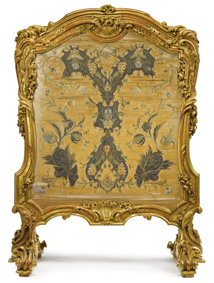 A LOUIS XV STYLE CARVED GILTWOOD FIRE SCREEN 19TH CENTURY  upholstered à châssis with heavily embroidered silk panel worked in polychrome silk and silver metal thread, probably French or Italian, circa 1700.