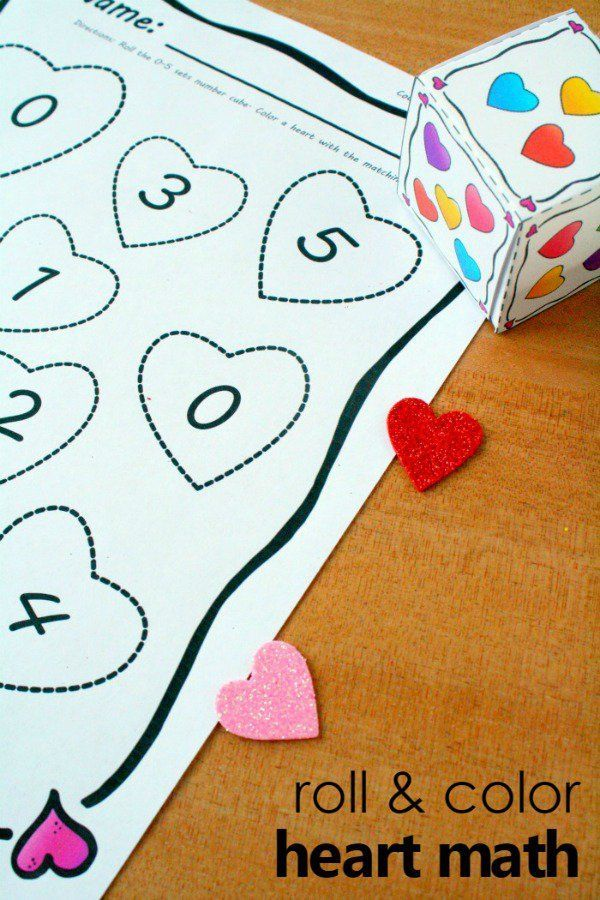 Roll and color heart math counting activity for preschool and kindergarten with free printable. Hands-on Valentine's Day learning activity