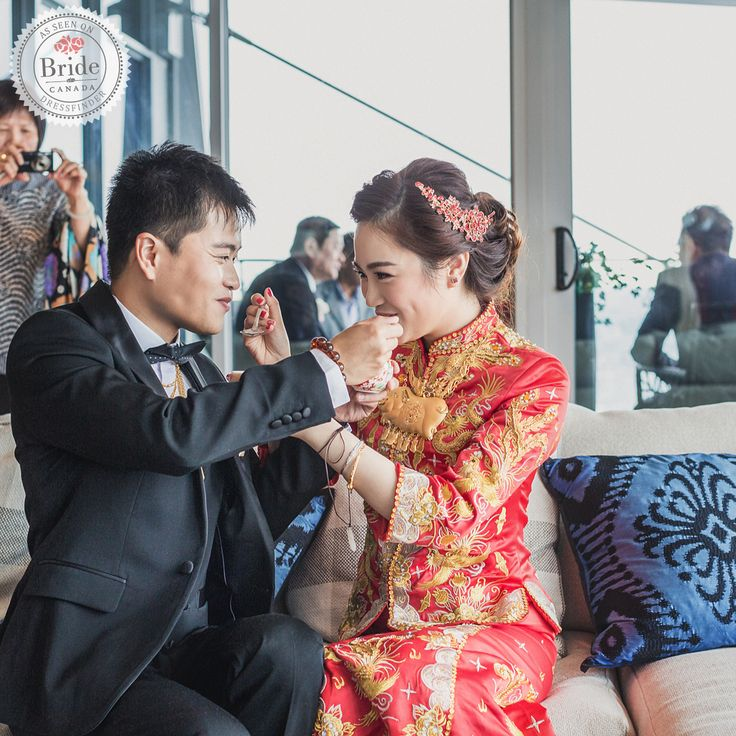 """#weddinginspo: To keep with tradition, the couple held a Chinese Tea Ceremony for their friends and family and Jolin wore a traditional """"Chinese Kua"""", a one piece dress, and a little blazer decorated with golden phoenixes symbolizing good luck. . . . Photography: @simwedding.ca Hair and Makeup: @TiffanysProMakeup Flowers: @balconifloral Event Planner: @wedoweddingsetc"""