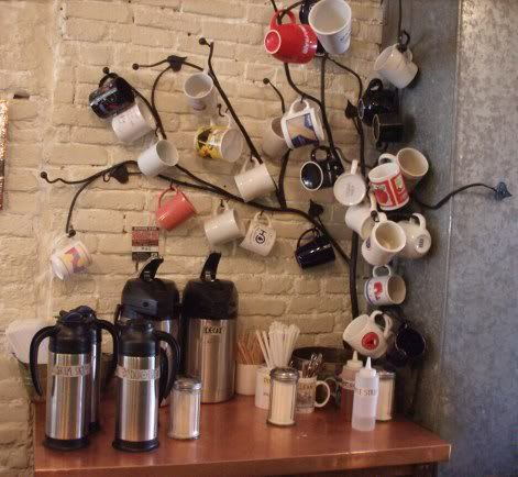 Insanely cool coffee mug tree! If you were into that sort of thing you could probably craft something similar in your shop. Im not sure how crafty I am - I think Id rather just buy it. :)