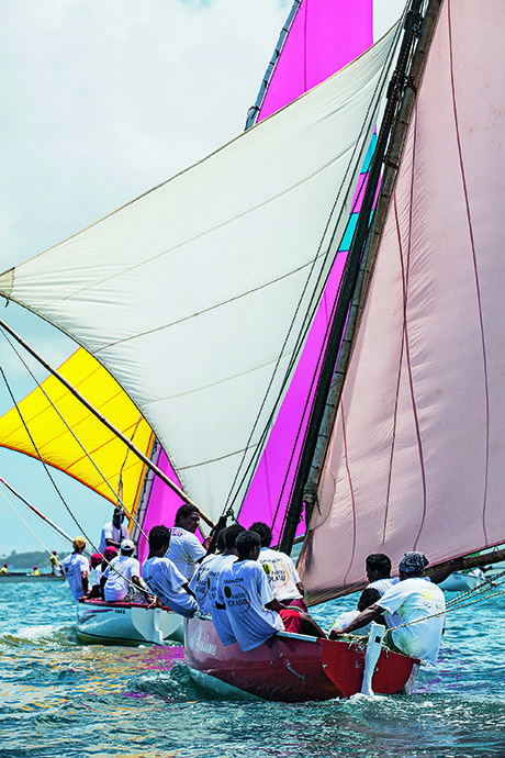 Colorful pirogues in #Mauritius turquoise lagoon