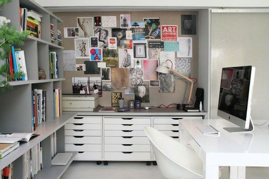 Great use of small office space - check out drawers from Ikea and put them under your work table.  Instant organization.