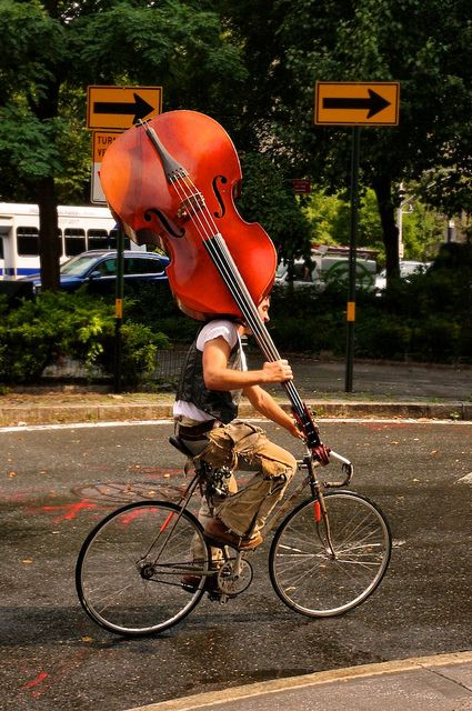 ♫♪ Music ♪♫ instrument biker rider Right place, right time. West Village, NYC. by bryantdavid77