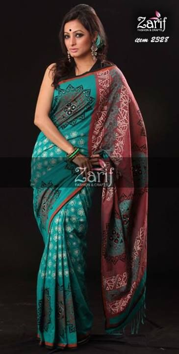 Look fascinating in this dual tone cotton saree. Festooned all over with intricate screen print cute paislay motifs. sequines inspired karchupi on motif.