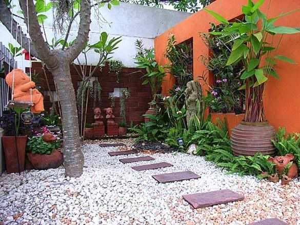Bali inspired garden... I love the pebbled flooring... great idea! The orange wall, I wouldn't have thought of that! But I like it!