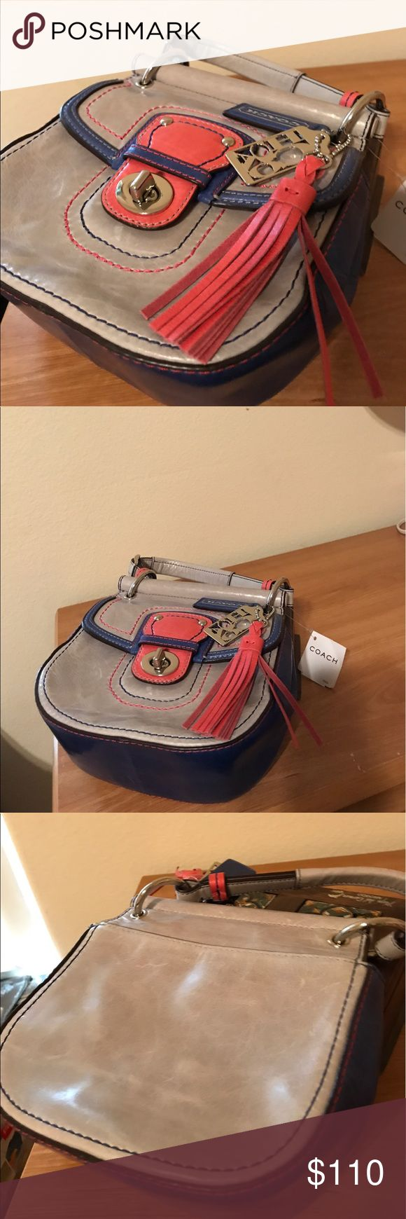Brand new with tags Coach Purse Brand new with tags, perfect condition Coach Purse. Small bag, perfect for going out with shoulder strap. Size is 6.5 across, about 6 inches tall and about 3 inches deep. Colors are gray, pink and cobalt blue. Price tag says $189. Material is leather. Coach Bags Crossbody Bags