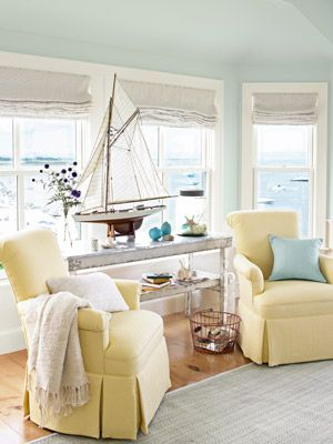 """I love the wall color in this, """"Icy Morn"""" by Benjamin Moore, along with the buttery yellow furniture and creamy white accents."""