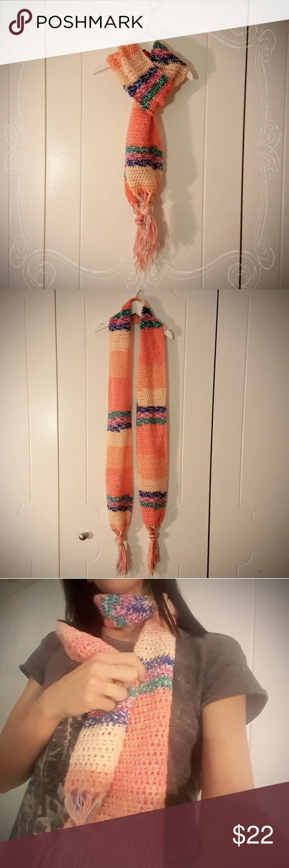 Urban Chic Crochet Coral Scarf with Tassels This scarf is an original design and is made of super soft cotton and acrylic yarn. No wool, non-itchy. Colors vary from coral to light orange with mixes of blue and teal. This scarf is great for any time of year due to it being lightweight and breathable. Give the gift of handmade this year! Measures 2 yards long by 6 inches wide. Tassels are approx 4 inches long (tassels can be untied for a fringe look). Matching hat also available for sale…