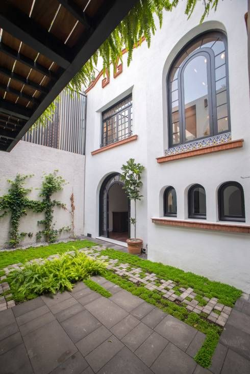 CASA EN HIPÓDROMO CONDESA: Jardines de estilo moderno por TW/A Architectural Group