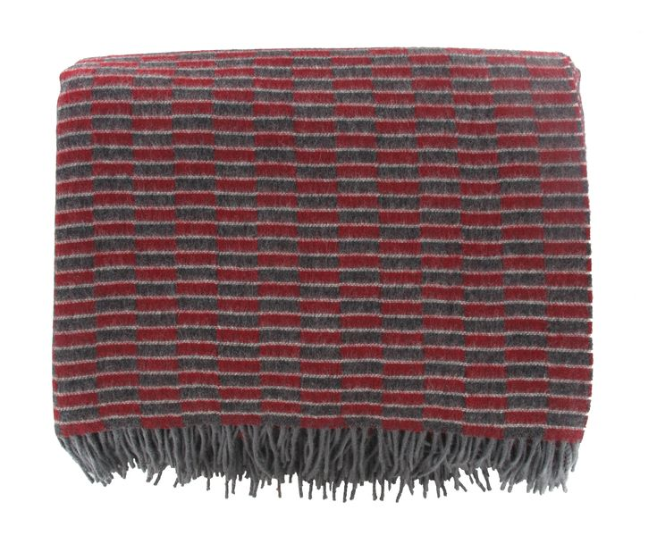 Brighten up your home or travel in style with this beautifully soft and stylish throw featuring the New Routemaster moquette design. Available now at London Transport Museum.