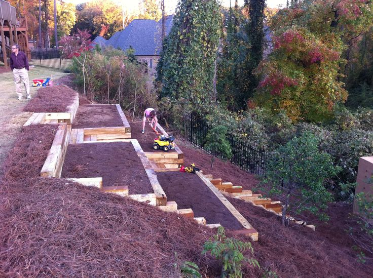 Pretty awesome raised garden beds on a hillside.