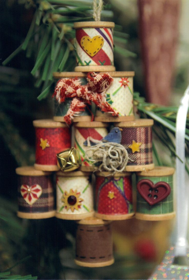 From another pinner:  Crafty crafts just made a little Christmas tree out of wooden spools. I used paper scraps to paper each spool. Just added different embellishments to enhance. So sweet.  these would make great ornaments on their own!