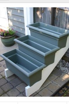 Purchase stair risers from your local home improvement store, paint it, and add some window boxes