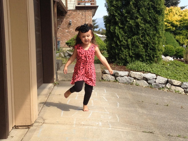 Playing hopscotch with my priceless grand daughter Evah this afternoon:) the invitation to play with her is golden